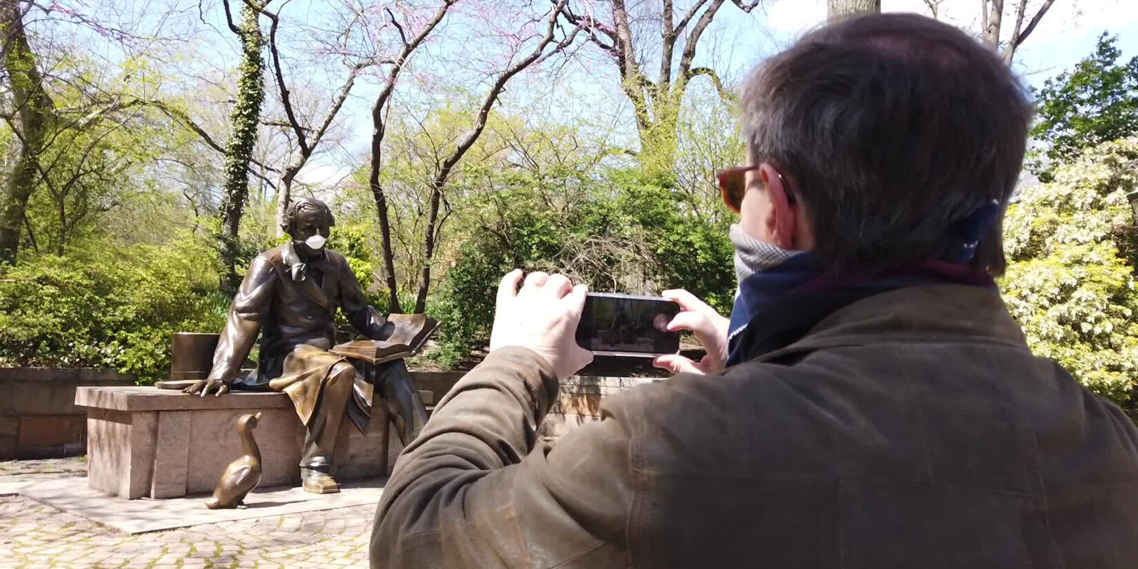 Mason photographing the Andersen statue by Conservatory Water