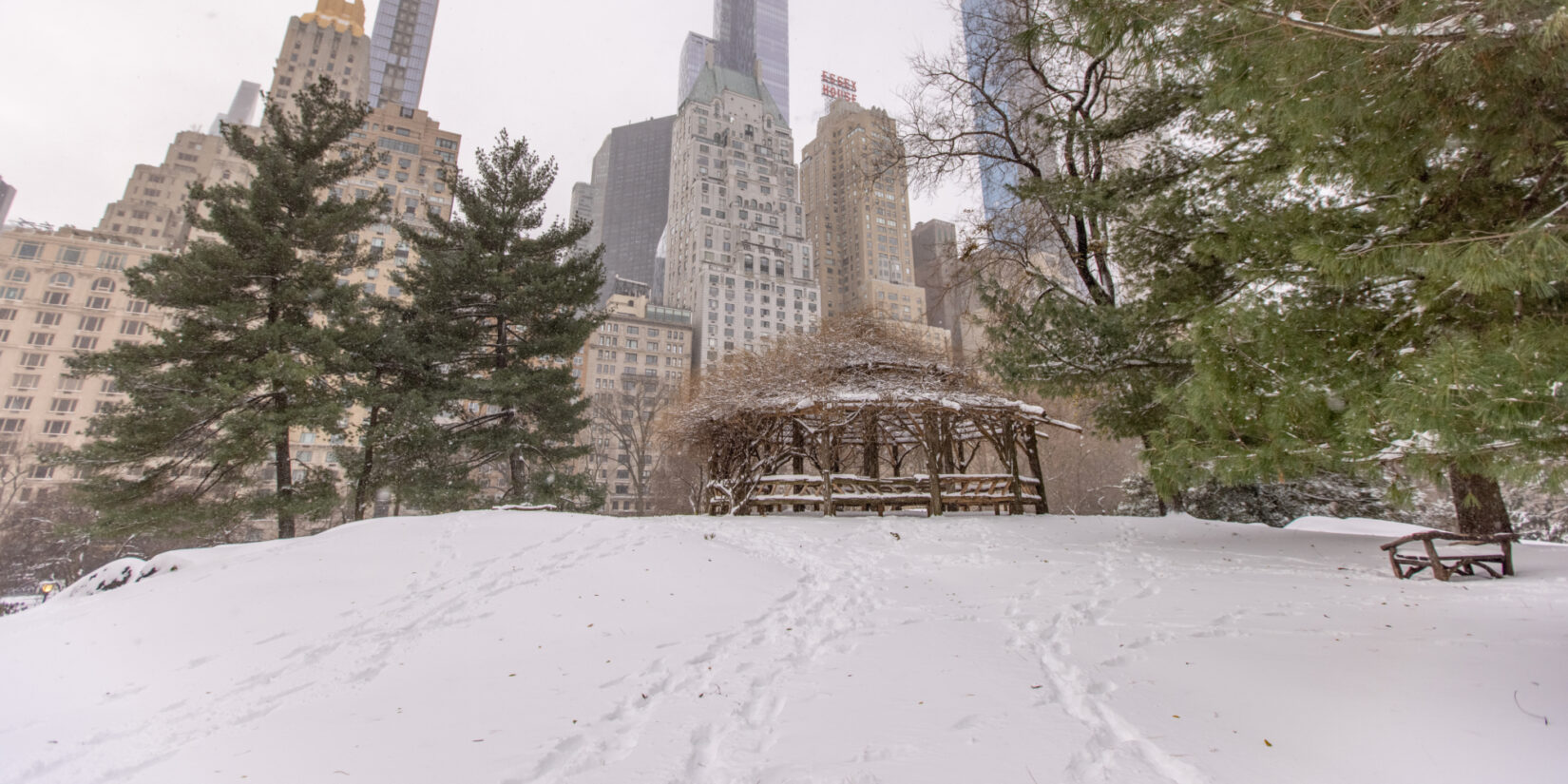 The rustic structure, Cop Cot, under a layer of snow