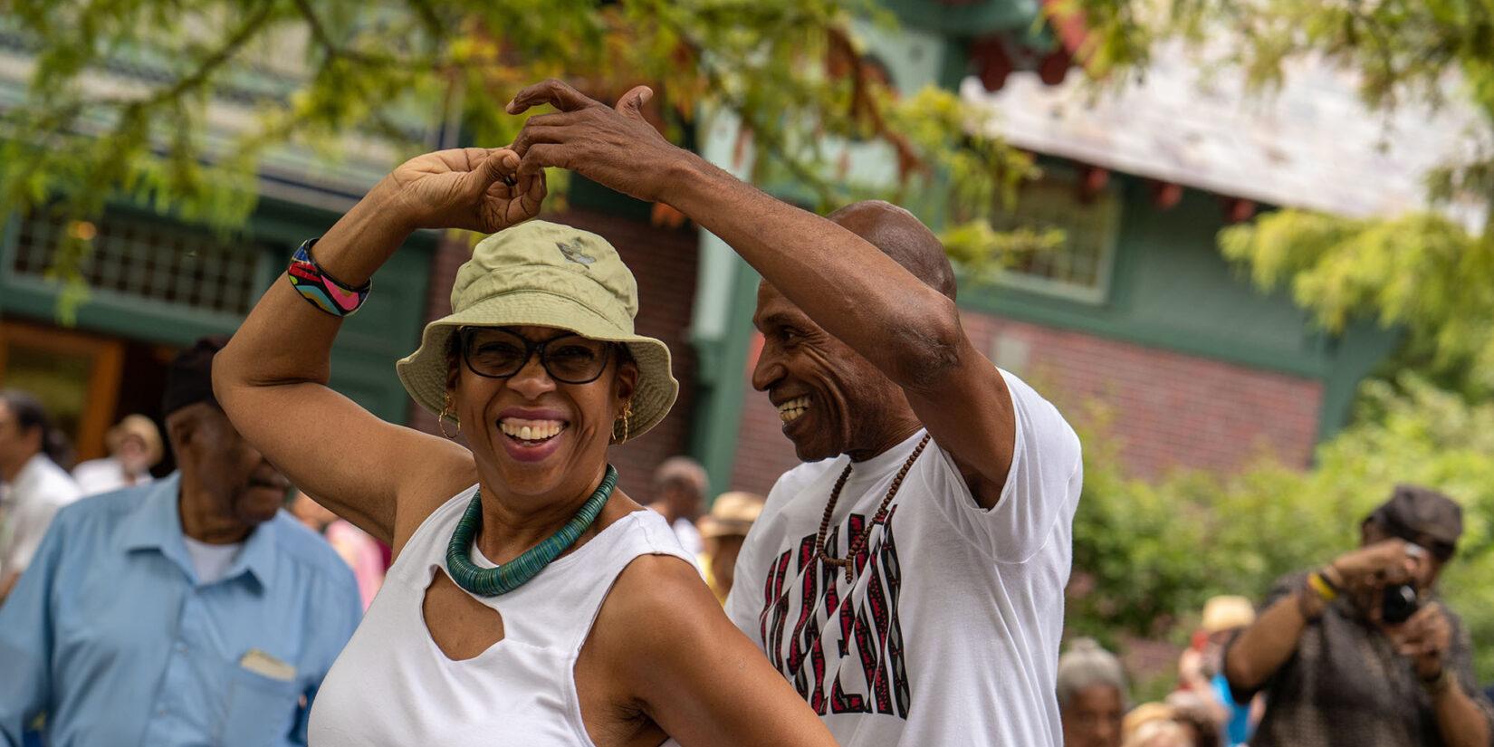 Two older dancers enjoying the rhythms of the festival