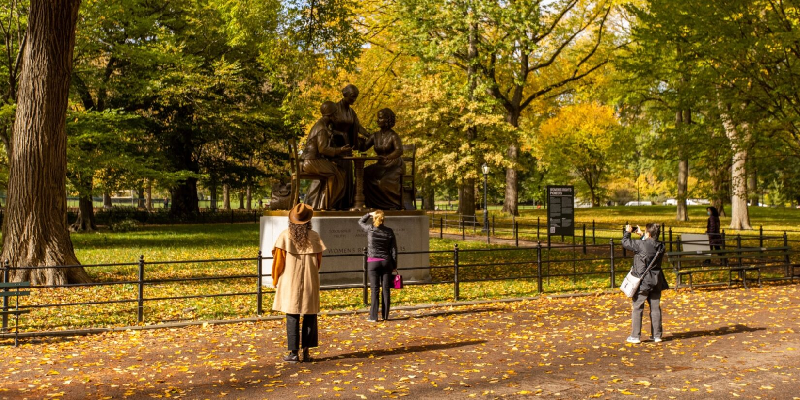 The monument is admired by a few parkgoers in autumn