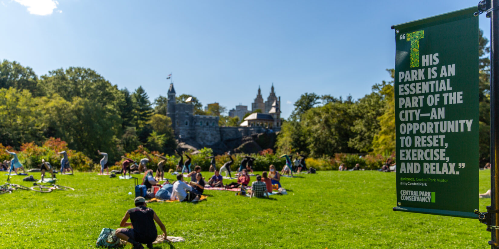 An example of the banners highlight this photo of parkgoers lounging on a lawn.