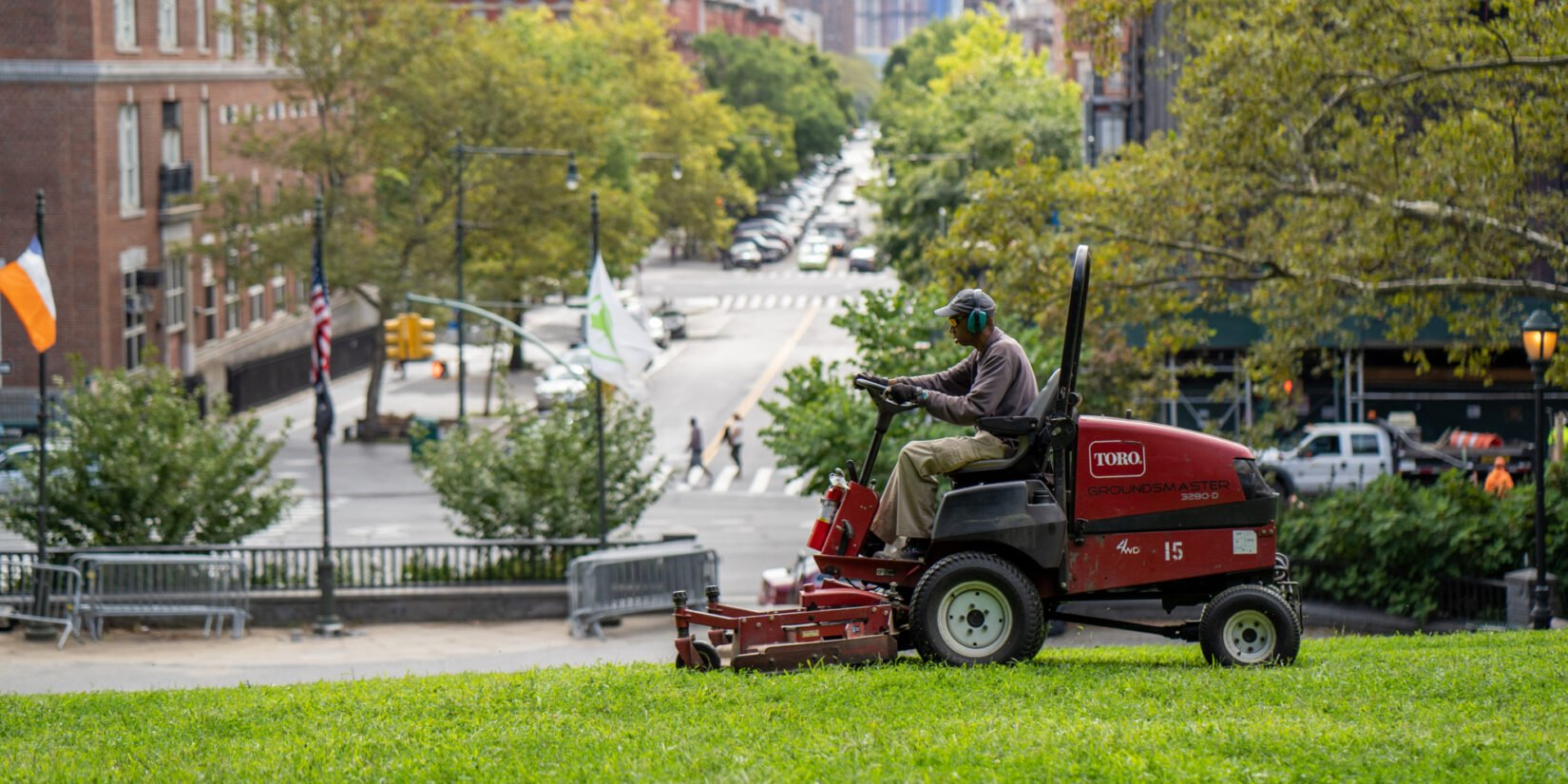 Conservancy groundskeeper on a riding mower