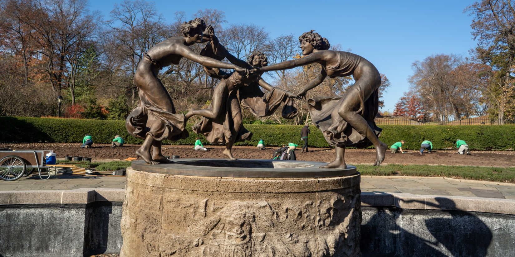 With the Untermeyer Fountain in the foreground, Park volunteers are seen working the flowerbeds.