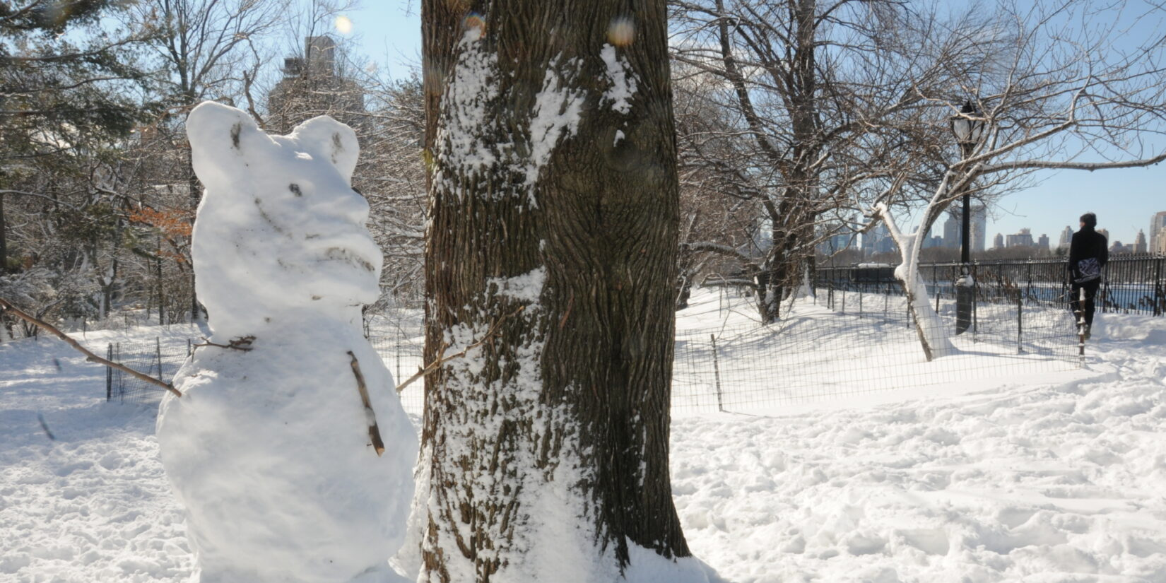 A snowbear (sic) stands wintry guard by the Reservoir