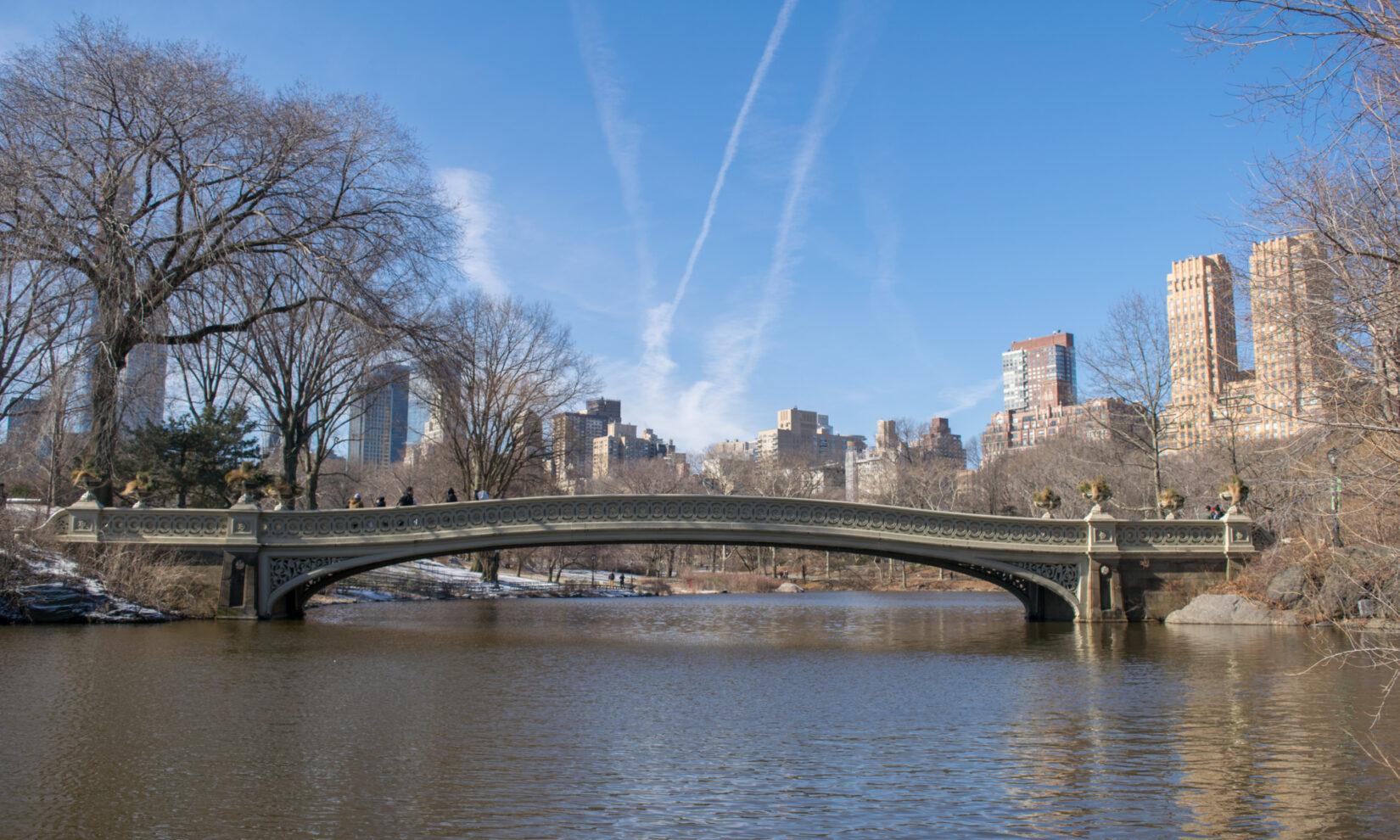 The bridge spans the Lake under a crisp, blue winter sky.