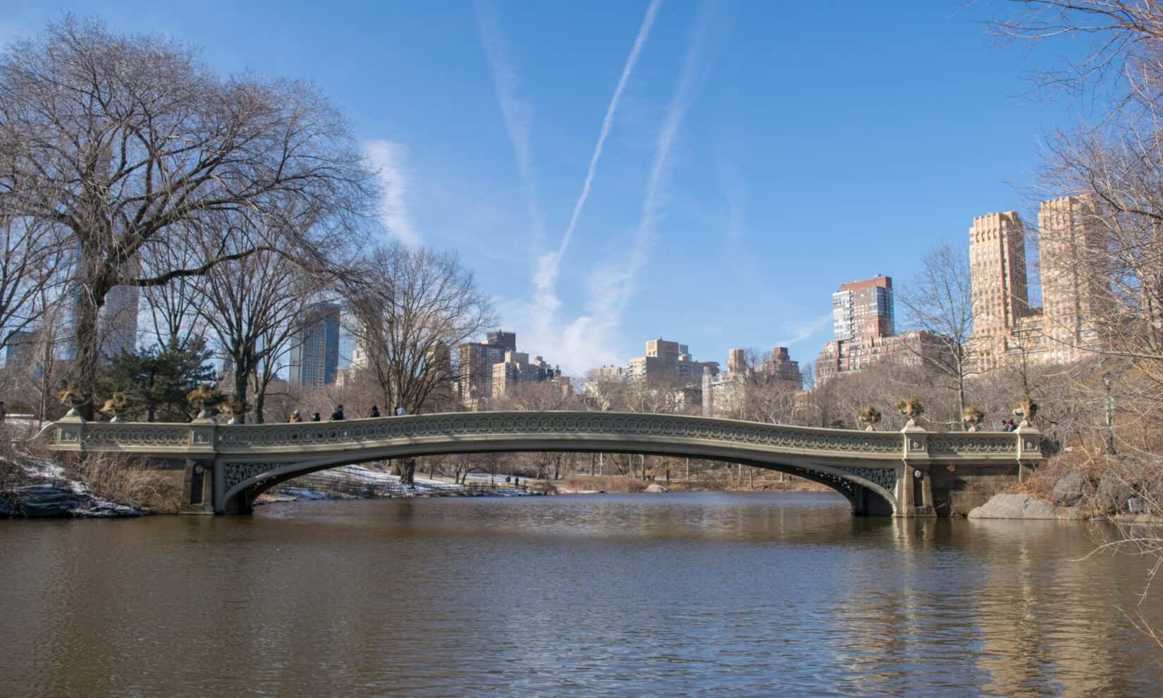 The bridge spans the Lake under a crisp, blue winter sky.