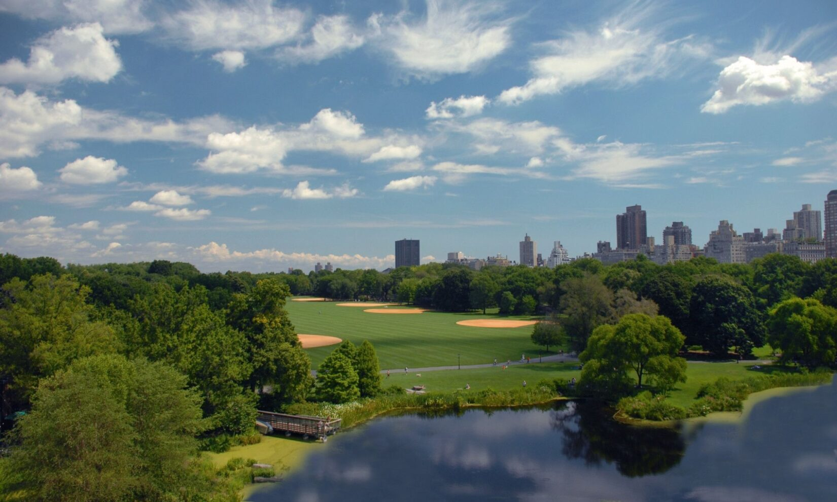 The Great Lawn seen from atop Belvedere Castle, with Turtle Pond in the foreground.