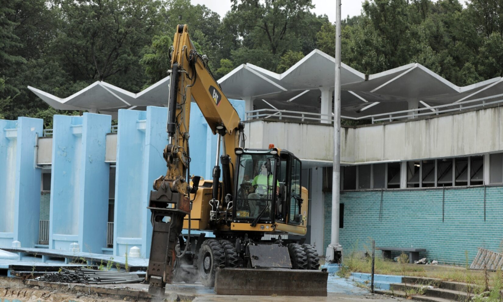 Heavy equipment accomplishes the groundbreaking at the old Lasker Rink and Pool.