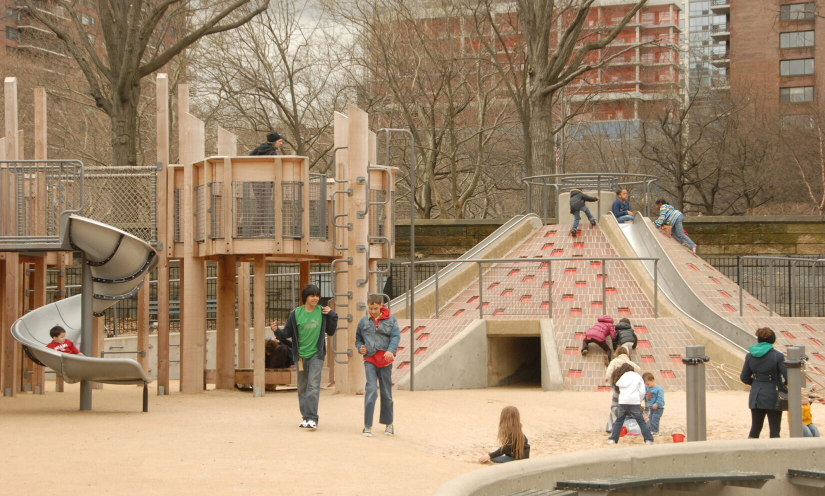 Children take advantage of multiple climbing and sliding options on a brisk, late-autumn day.