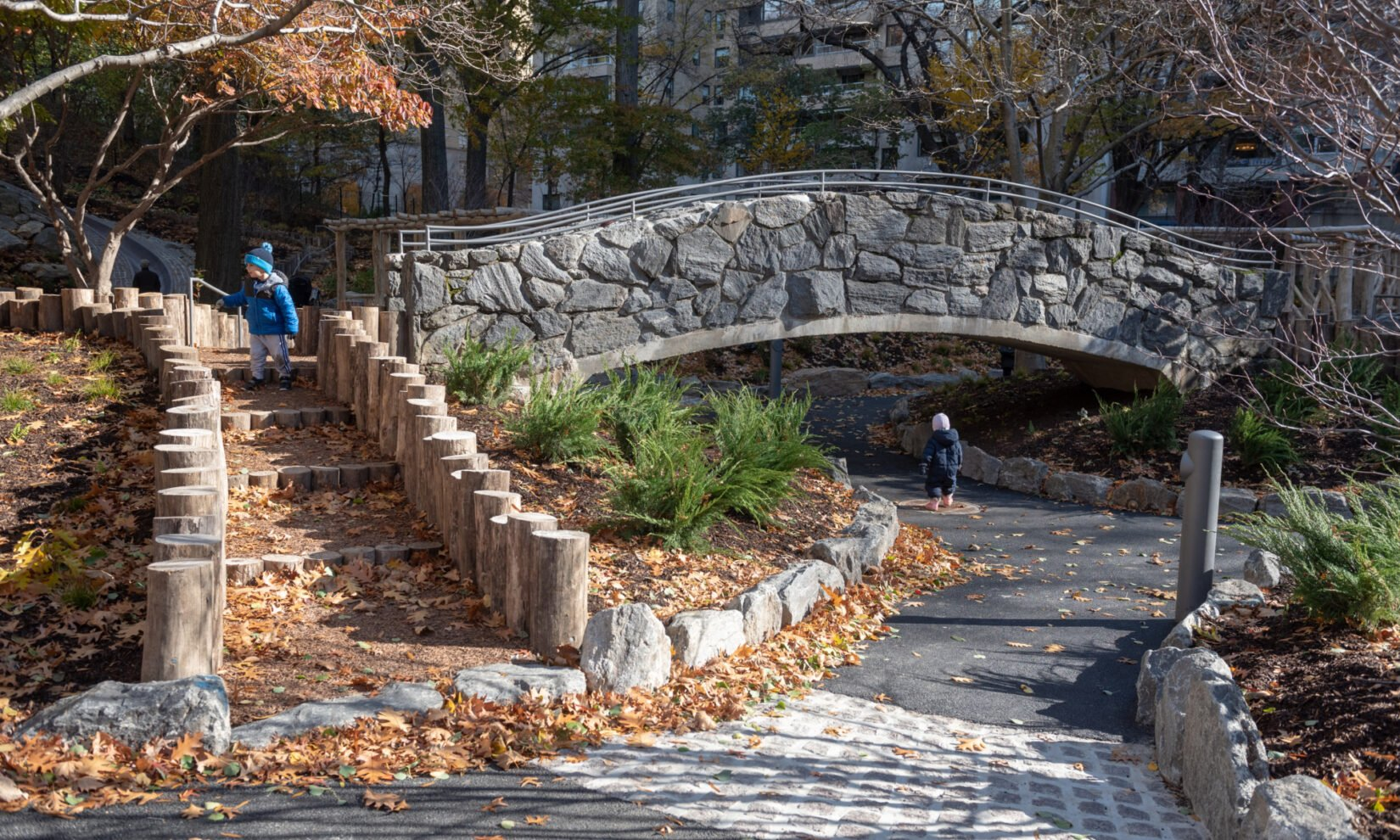 Rustic steps and a stone bridge are highlights of the playground.