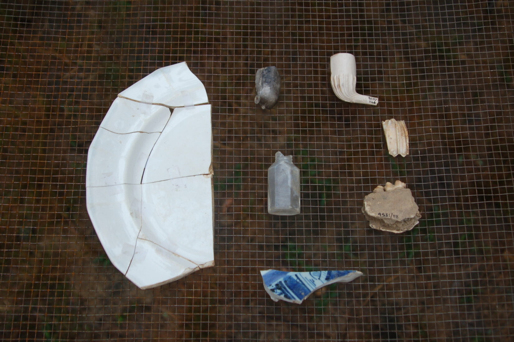 Excavated shards and pieces of smoking pipes