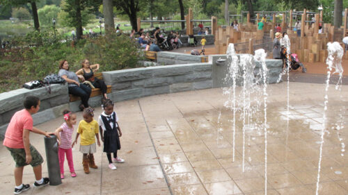 Kids cautiously approaching the water feature