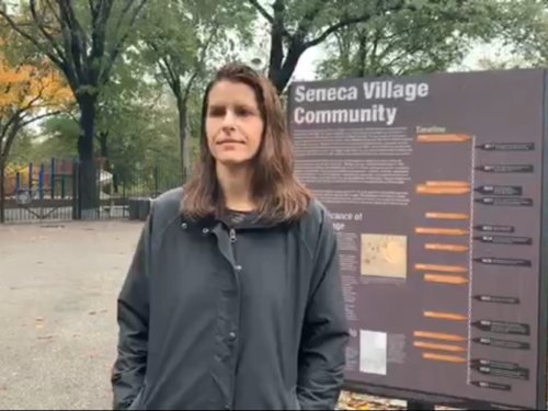 Screen grab of Facebook Live post featuring Conservancy historian Marie Warsh, showing Marie at the Seneca Village location