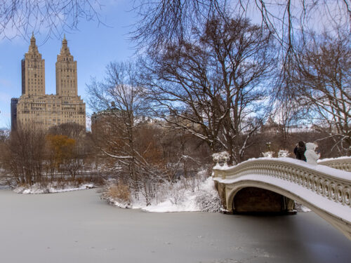 A winter view shows the graceful span of the bridge across the Lake.