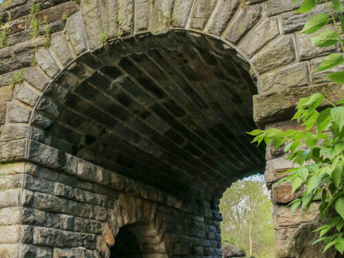 A dramatic angle of the arch showing architectural details on the interior