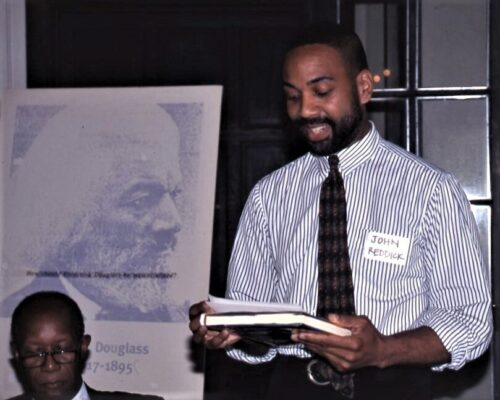 Photo of Howard Dodson in shirtsleeves and a tie