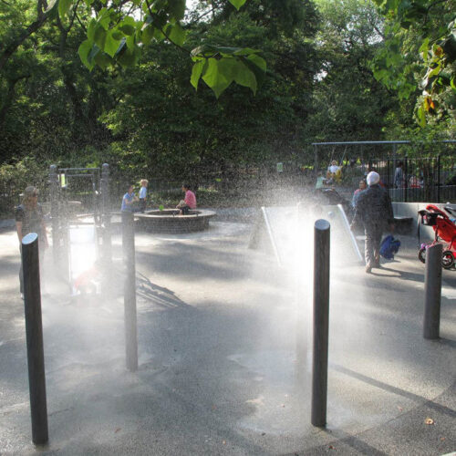 Water features spray the restored playground