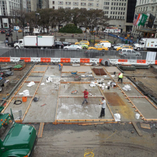 Construction workers restoring the Plaza
