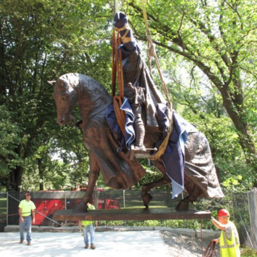 The statue being moved during its conservation