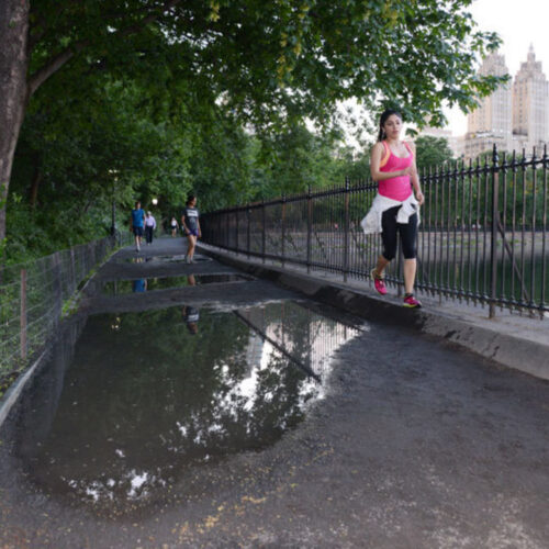A large puddle on the running track shows the need for reconstruction