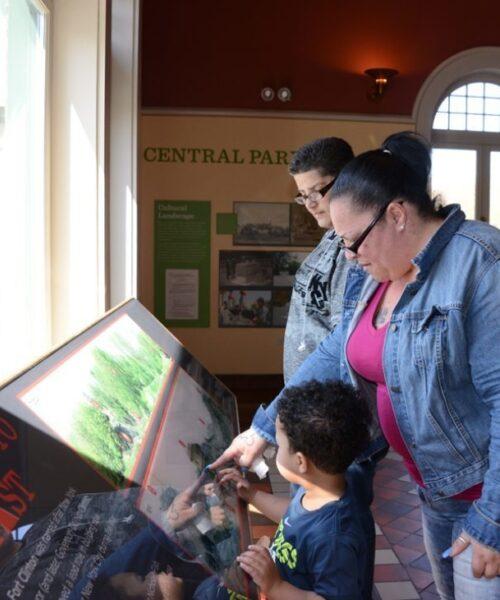 Visitors examining the Landforms exhibit