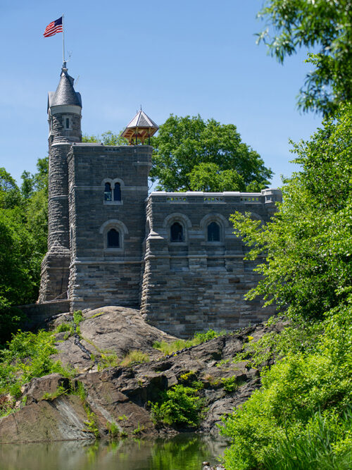 The refurbished castle in brilliant sunlight, with an American flag flying from the top