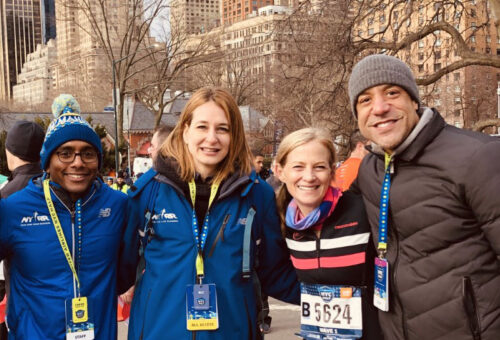 Mary Wittenberg and three colleagues at the NYC Half