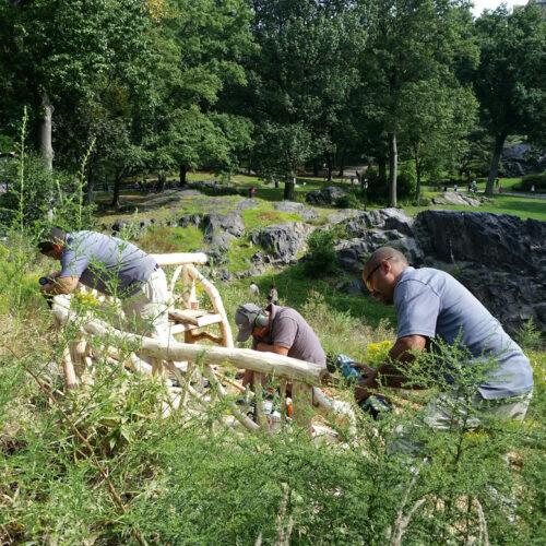 Conservancy artisans contructing rustic seating