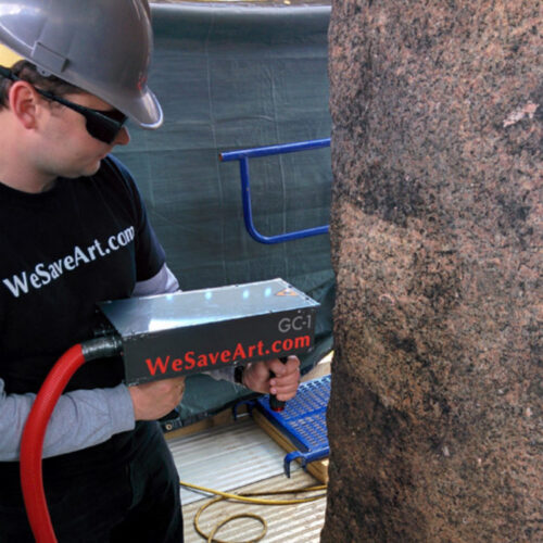 A worker uses a laser to clean the Obelisk