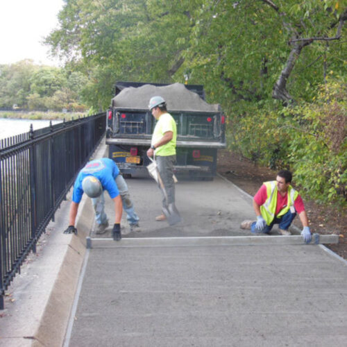 Workers leveling the running track