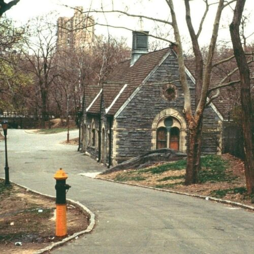The Dairy in 1980 on a gray winter day, surrounded by bare trees and a paved road.