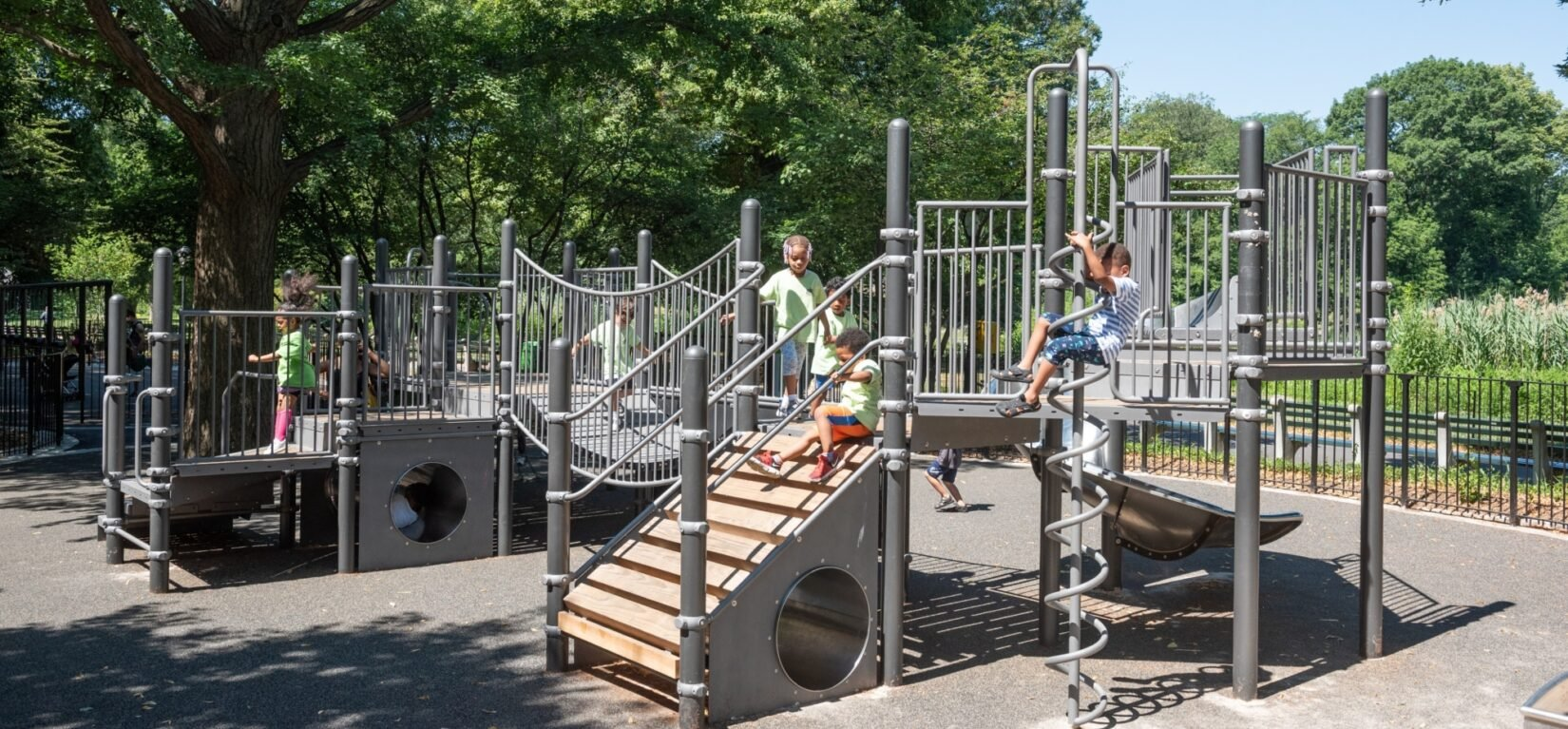 Small children enjoy the play structures in the playground