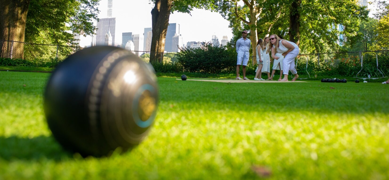 Lawn bowlers practicing their craft in summer