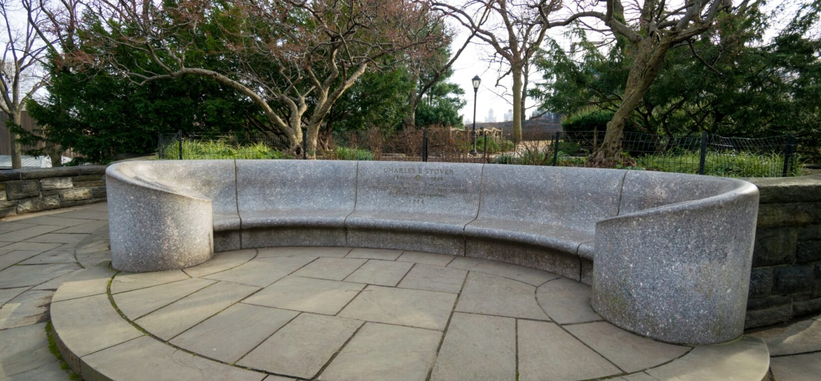The granite bench is long and gently curved.