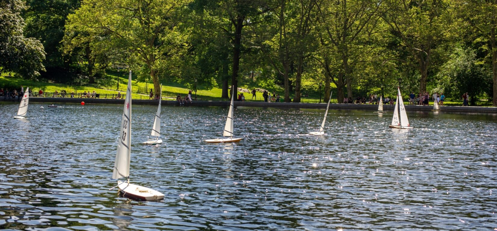 Model sailboats dance on the surface of Conservatory Water