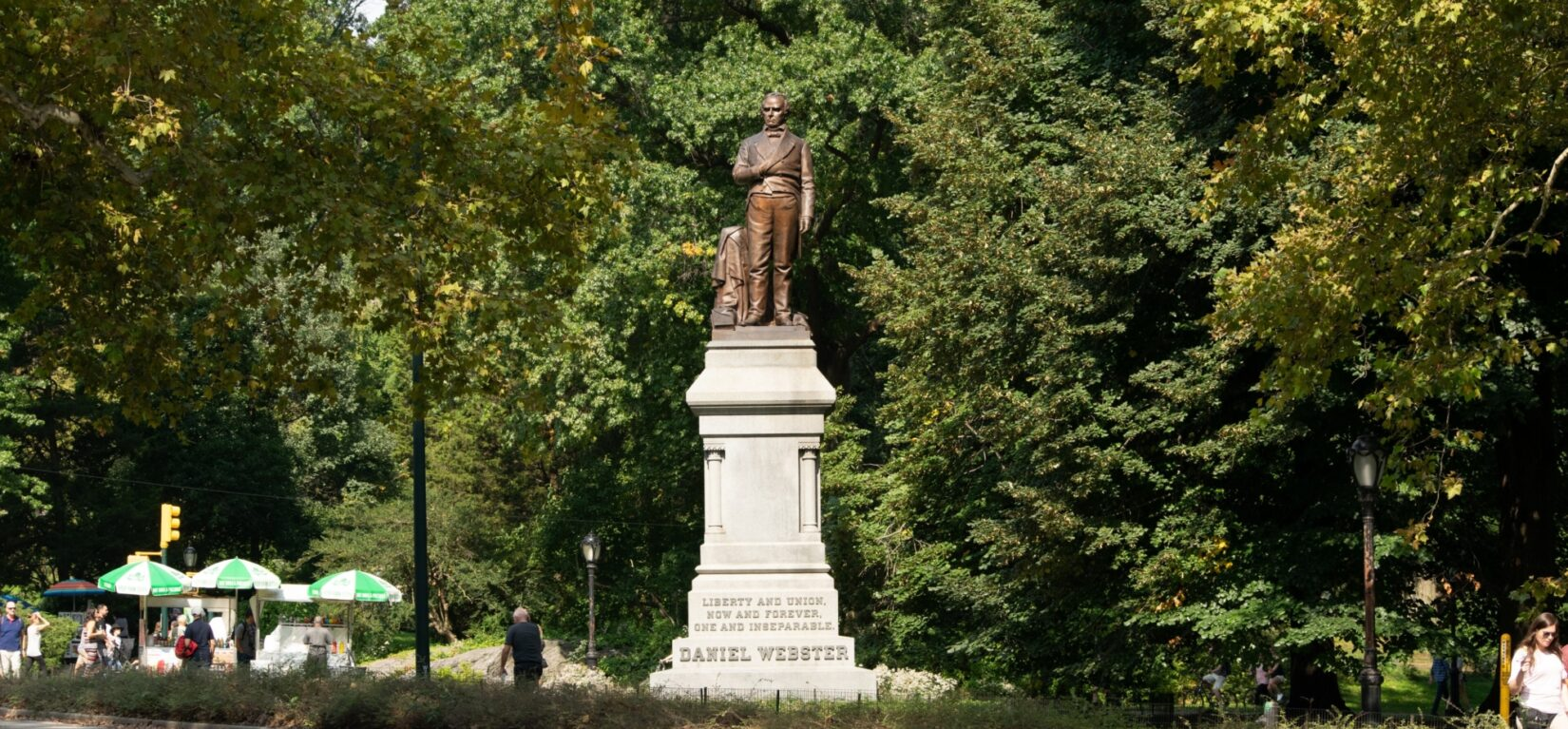 The bronze statue stands high on a noble pedestal