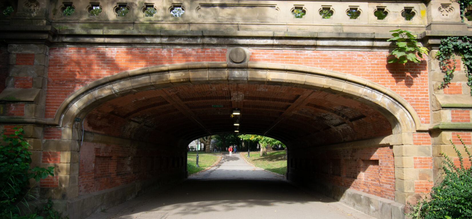 A view looking through the red-bricked Driprck Arch