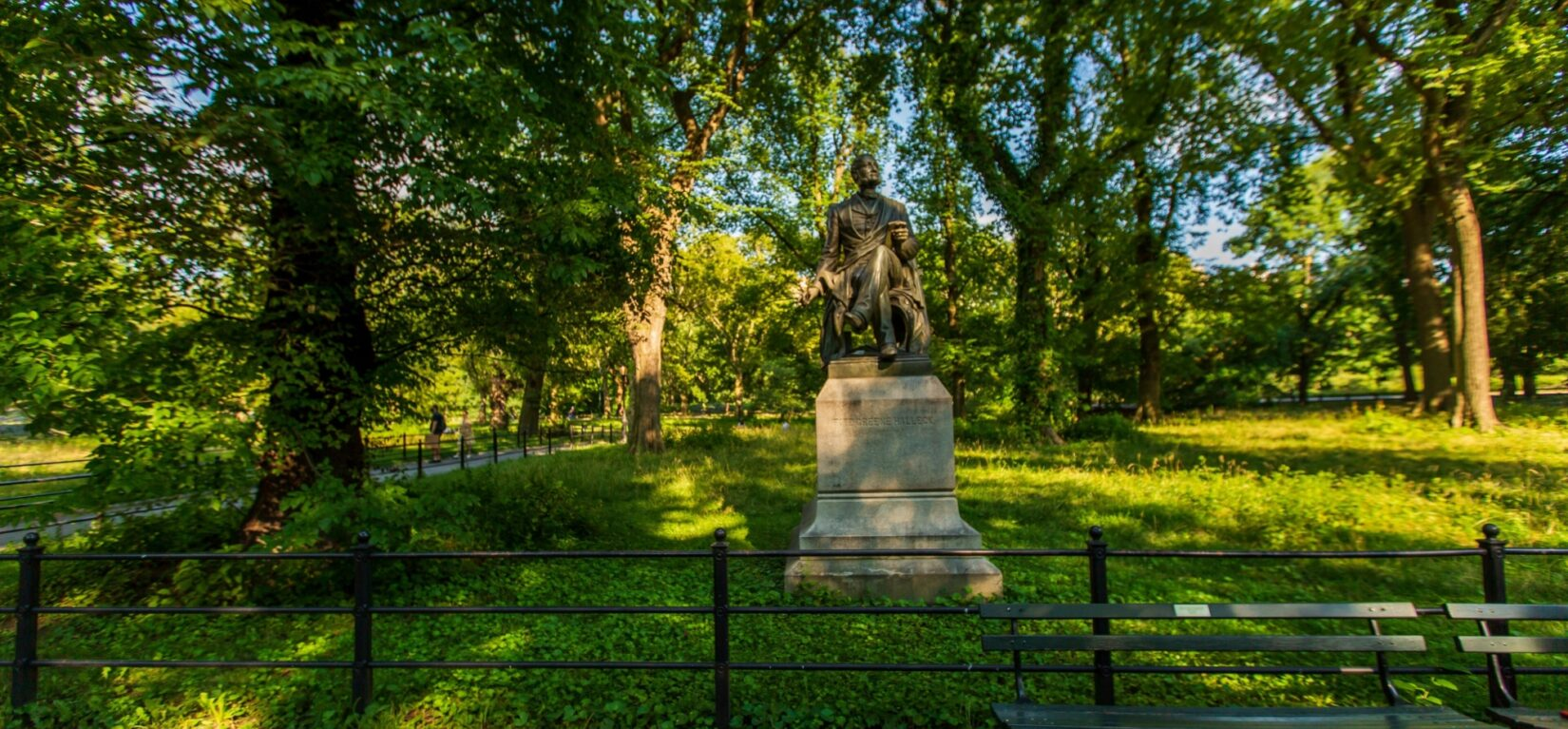 The statue of Halleck sitting under leafy trees
