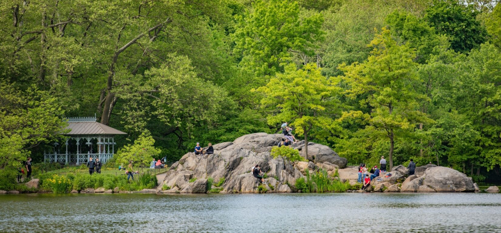 Visitors enjoy the view of the Lake from the rocks of Hernshead