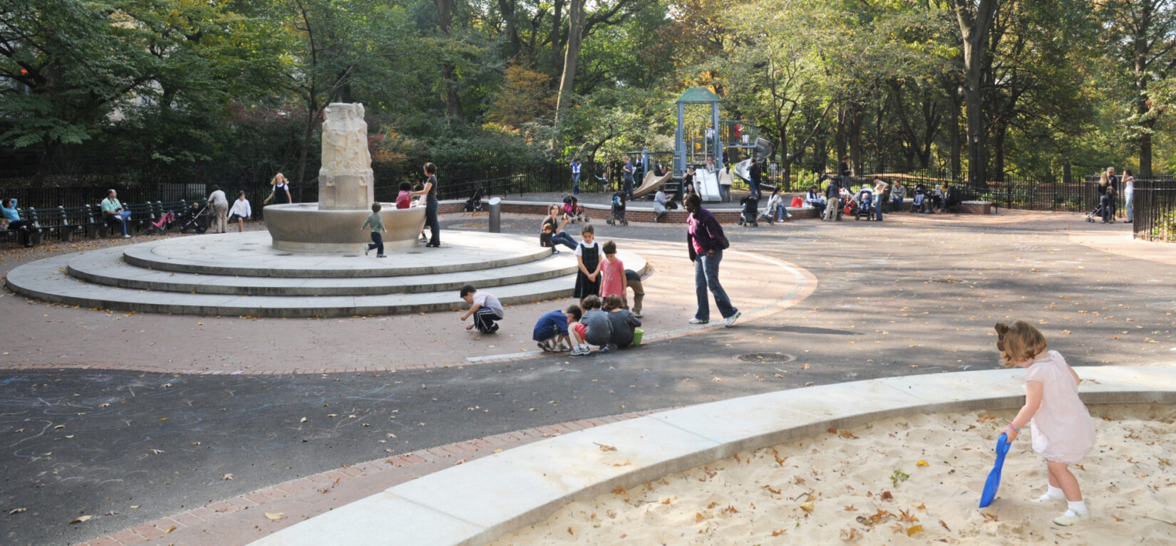 Children enjoying the fountain feature of the playground