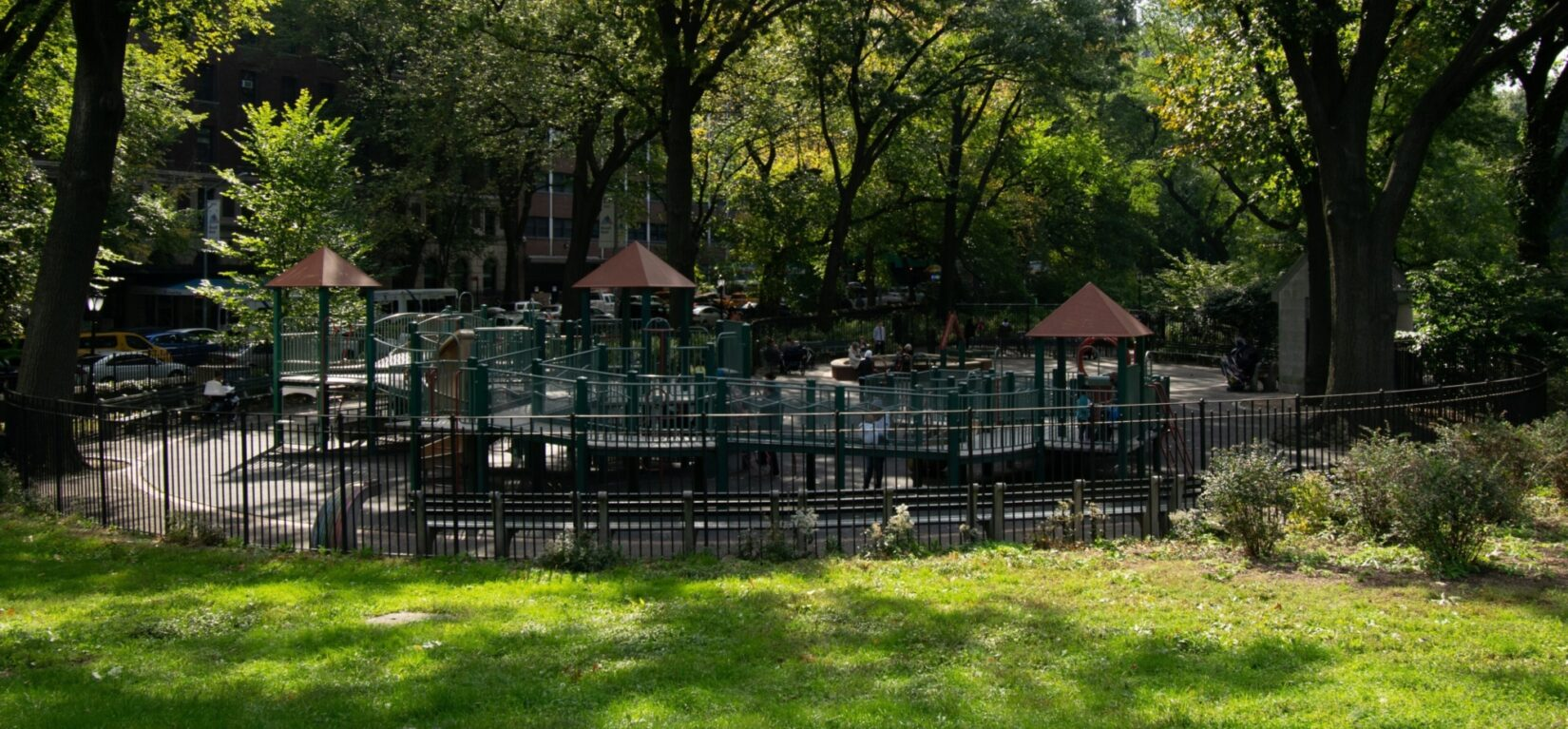A view of the playground from afar, highlighting the green surroundings