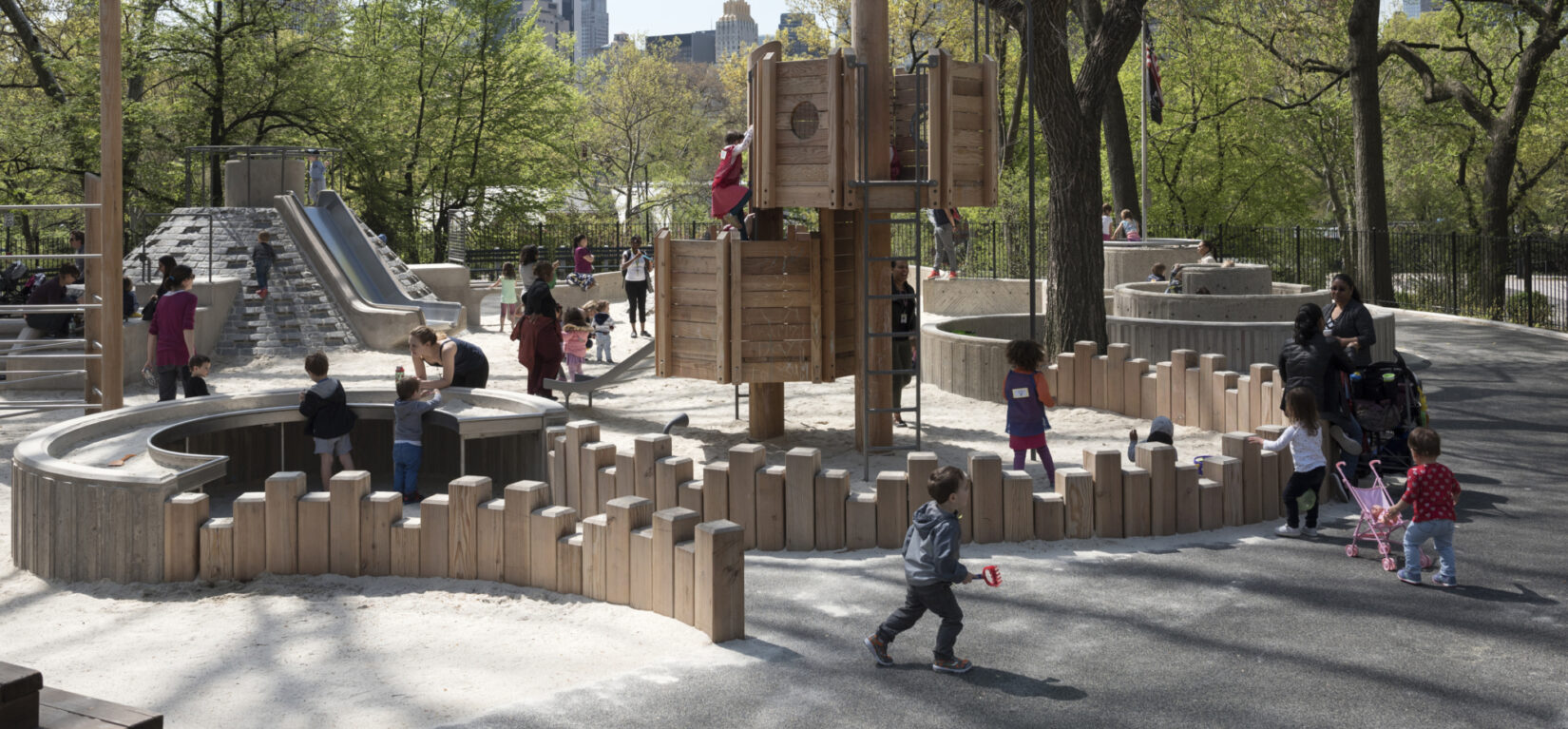 Small children playing on a crisp spring day in Adventure Playground