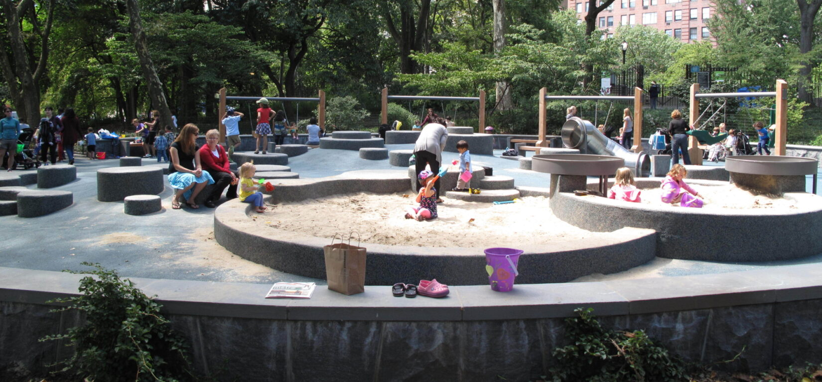 Toddlers enjoy playing in the sand in summer