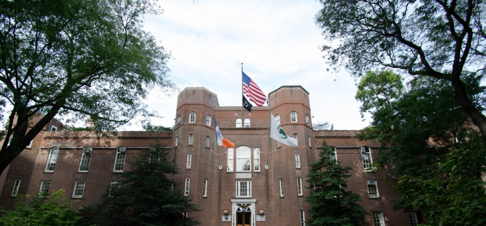 The imposing facade of the Arsenal, with flags waving from three poles
