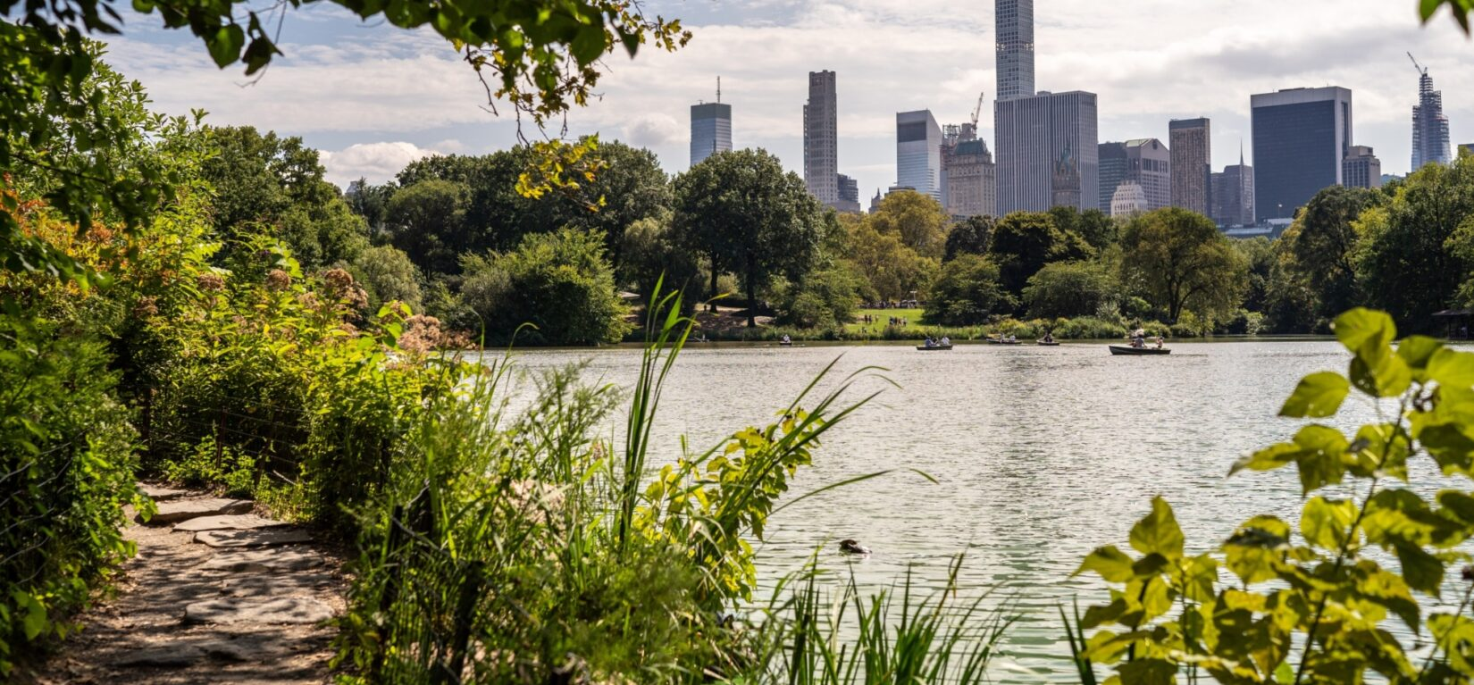 A view looking across the lake toward the skyline of Manhattan's East Side